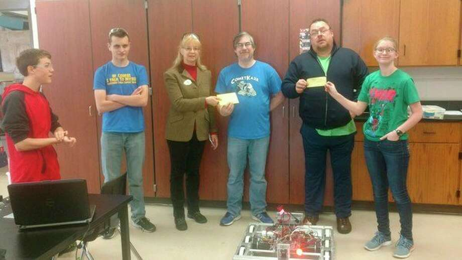 From left, Nicholas Rudy; William Houghten; Ann Sigsby, worthy matron of Coleman OES; Peter Cauchy, CometKaze coach; Fred Servis, past master of Warren Lodge; and Haley Nichols receive donations for their robotics competition. (Photo provided)