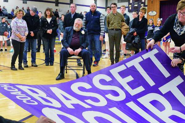 Former CCHS coach Don Bassett , seated, is honored in a ceremony naming the school's basketball court after him Friday Feb. 9, 2018 in Troy, NY.  (John Carl D'Annibale/Times Union)