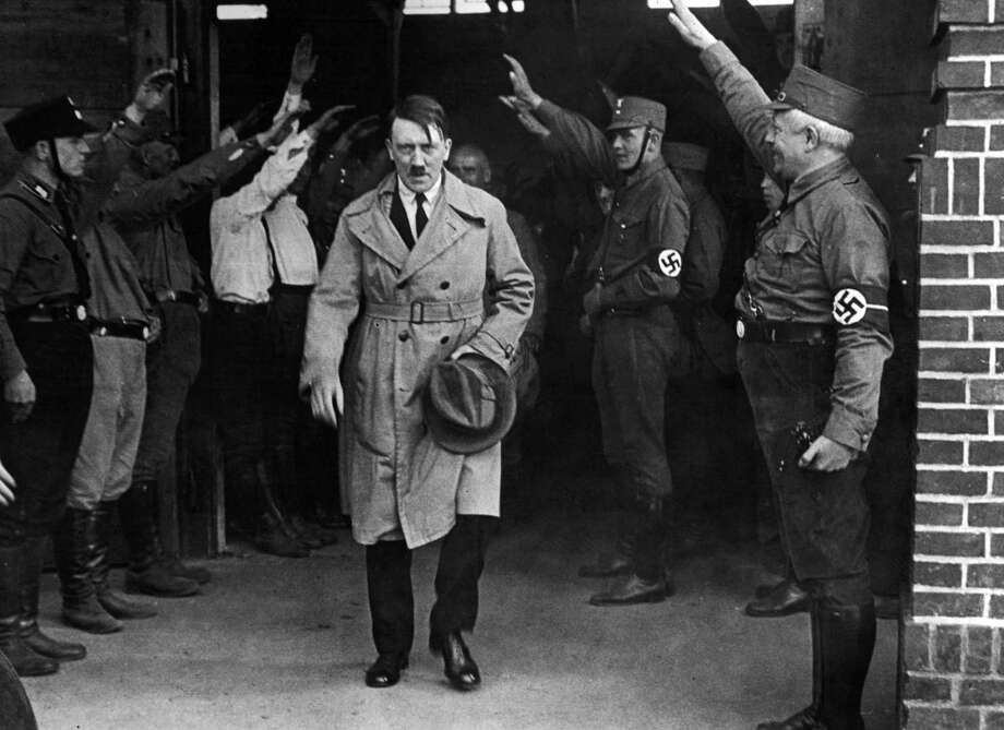 FILE - In this Dec. 5, 1931 file photo, Adolf Hitler, leader of the National Socialists, is saluted as he leaves the party's Munich headquarters. In Munich, Hitler launched his political career with speeches condemning Jews and proclaiming the ethnic superiority of Germans. (AP Photo, File) ORG XMIT: NYET153 / AP