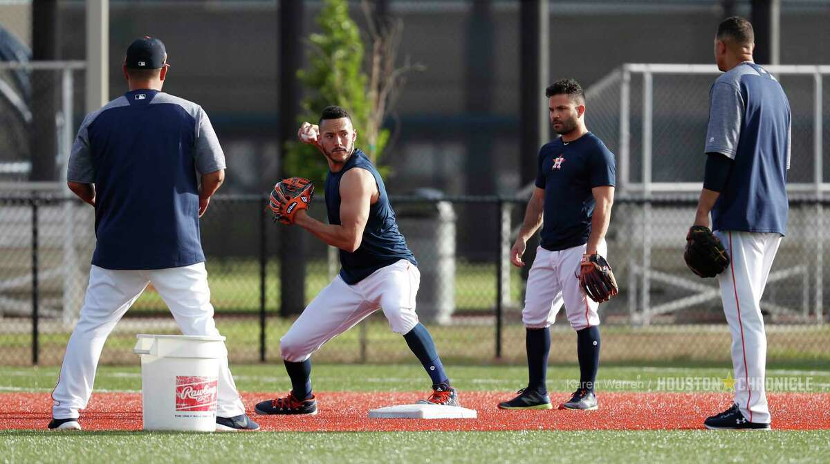 Houston Astros Carlos Correa (1) and Jose Altuve (27) work on drills early during spring training day at The Ballpark of the Palm Beaches, Tuesday, Feb. 20, 2018, in West Palm Beach .