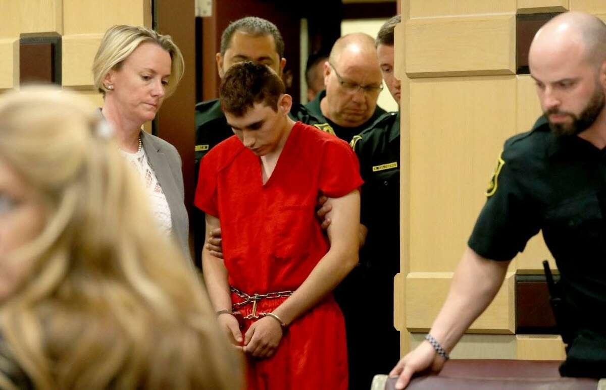 Nikolas Cruz appears in court with attorney Melissa McNeil, left, for a status hearing before Broward Circuit Judge Elizabeth Scherer Feb. 19 in Ft. Lauderdale, Florida.
