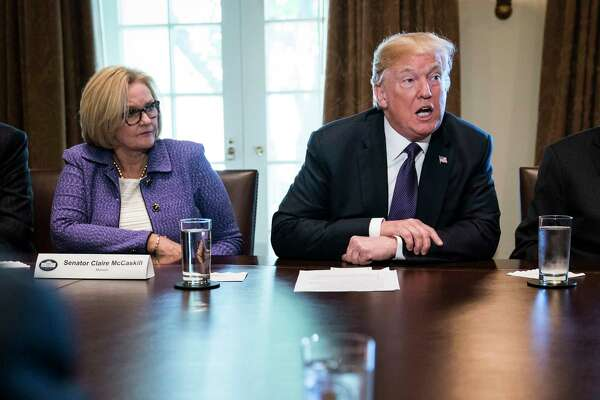 President Trump, flanked by Sen. Claire McCaskill, D-Mo., speaks during a meeting with members of the Senate Finance Committee on Oct. 18.