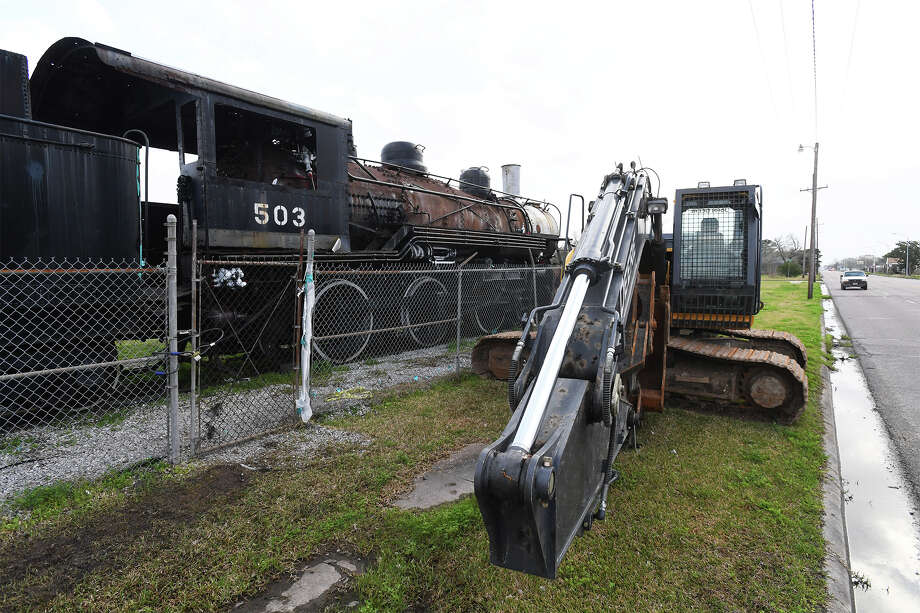 A demolition crane is parked next to the Kansas City Southern locomotive on display at Bryan Park in Port Arthur on Monday.  Local supporters of the historic train are raising money to prevent its destruction. Deadline for the fundraisers is Wednesday. Photo taken Monday, February 19, 2018 Guiseppe Barranco/The Enterprise Photo: Guiseppe Barranco, Photo Editor / Guiseppe Barranco ©