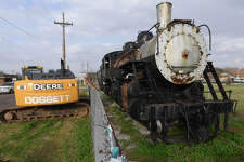 A demolition crane is parked next to the Kansas City Southern locomotive on display at Bryan Park in Port Arthur on Monday.  Local supporters of the historic train are raising money to prevent its destruction. Deadline for the fundraisers is Wednesday. Photo taken Monday, February 19, 2018 Guiseppe Barranco/The Enterprise