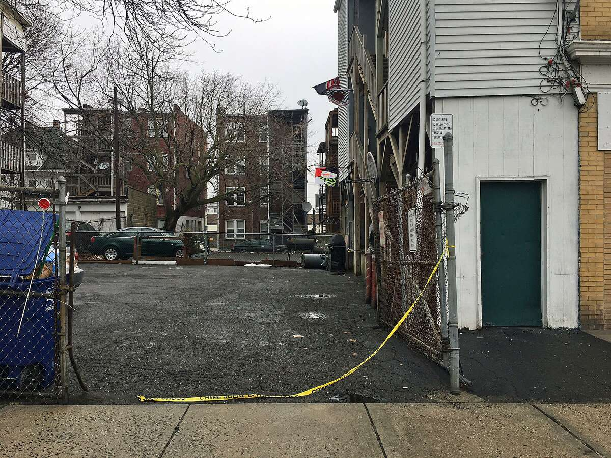 Crime scene tape is seen near the Fairfield Avenue apartment building where a sixteen-year-old Francine Nyanzaninka was fatally stabbed to death on Monday, Feb. 19, 2018. Her uncle, Richard Segabiro, 31, was charged with murder and is being held on a $1,000,000 bond. Police say Segabiro later confessed to the murder.