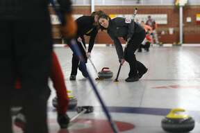 Julia DiBaggio of Mayfield Curling Club looks up during the Great Lakes Curling Association's Mixed Curling Championship at the Midland Curling Center in Midland on Sunday, Feb 19, 2018. (Samantha Madar/for the Daily News)