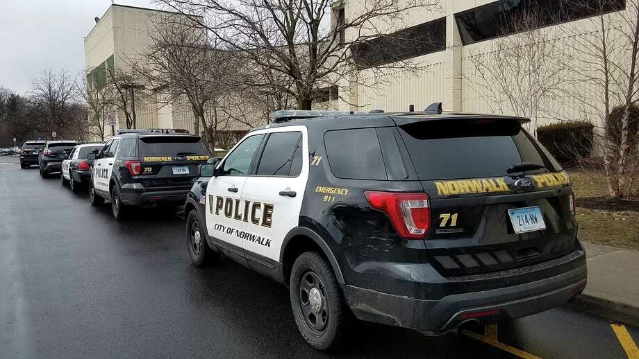 Police arrive at Norwalk High School following a reported disturbance Tuesday February 20, 2018 in Norwalk Connecticut Photo: Erik Trautmann / Hearst Connecticut Media / Norwalk Hour