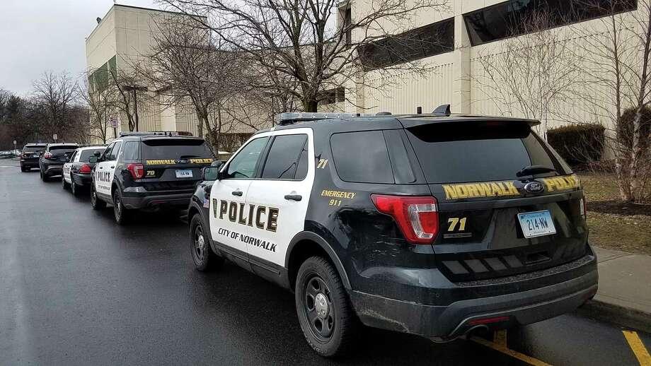 Police arrive at Norwalk High School following a reported disturbance Tuesday February 20, 2018 in Norwalk Connecticut Photo: Erik Trautmann / Hearst Connecticut Media / Norwalk Hour