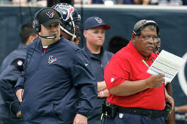 Houston Texans head coach Bill O'Brien, left, and defensive coordinator Romeo Crennel work the sidelines during the second quarter of an NFL football game against the San Diego Chargers at NRG Stadium on Sunday, Nov. 27, 2016, in Houston. ( Brett Coomer / Houston Chronicle )