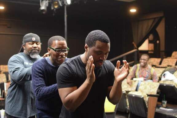 """Ty Fisher, left, Shun Lauren and Marvin Young perform in """"Miss Evers' Boys"""" at Pearl Theater. The play is a fictionalized depiction of how poor black farmers were mislead to participate in a study that promised to treat their syphilis but instead recorded how the untreated disease ravaged their bodies over time."""