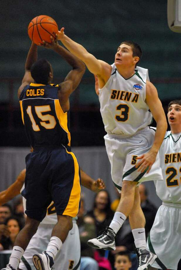 Siena's Kyle Downey defends against Canisius Julius Coles, left, during the first half of Siena's 82-70 win at the Times Union Center in Albany Monday night January 11, 2010. (Philip Kamrass / Times Union) Photo: PHILIP KAMRASS / 00006713A