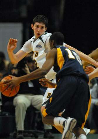 Siena's Ryan Rossiter defends against Canisius Julius Coles, foreground, during Siena's 82-70 win at the Times Union Center in Albany Monday night January 11, 2010. (Philip Kamrass / Times Union) Photo: PHILIP KAMRASS / 00006713A