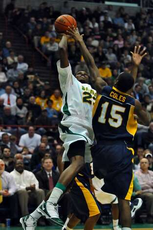 Siena's Edwin Ubiles puts up a shot against Canisius Julius Coles, right,  during Siena's 82-70 win at the Times Union Center in Albany Monday night January 11, 2010. (Philip Kamrass / Times Union) Photo: PHILIP KAMRASS