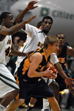 Siena's Alex Franklin, left, and Edwin Ubiles defend against Canisius Robert Goldsberry, foreground,  during Siena's 82-70 win over Canisius at the Times Union Center in Albany Monday night January 11, 2010. (Philip Kamrass / Times Union) Photo: PHILIP KAMRASS / 00006713A