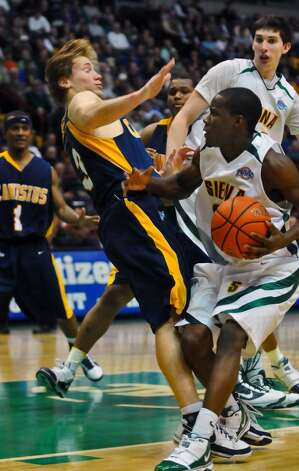 Canisius Robert Goldsberry, left, collides with Siena's Ronald Moore during Siena's 82-70 win over Canisius at the Times Union Center in Albany Monday night January 11, 2010. (Philip Kamrass / Times Union) Photo: PHILIP KAMRASS