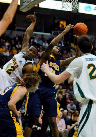 Siena's Alex Franklin collides with Canisius' Robert Goldsberry, bottom. (Philip Kamrass / Times Union) Photo: PHILIP KAMRASS