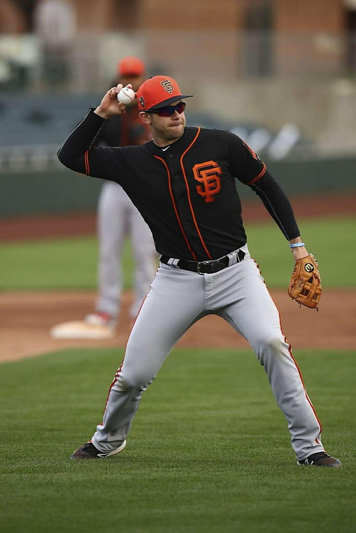 San Francisco Giants' Evan Longoria during a spring training baseball practice on Monday, Feb. 19, 2018 in Scottsdale, Ariz.