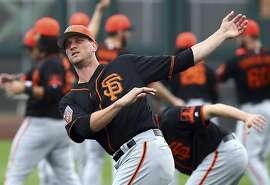 San Francisco Giants' Tony Watson stretches during a spring training baseball practice on Monday, Feb. 19, 2018 in Scottsdale, Ariz. (AP Photo/Ben Margot)