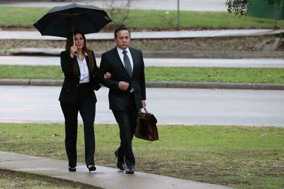 Texas State Sen. Carlos Uresti and his wife, Lleanna, arrive at the John H. Wood, Jr., United States Courthouse for closing arguments in his criminal fraud trial, Tuesday, Feb. 20, 2018. The charges stem from his involvement in the FourWinds Logistics company, a fracking sand venture. The company's consultant, Gary Cain, is a co-defendant in the case.