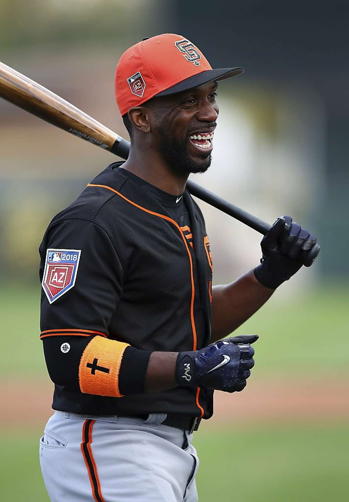 San Francisco Giants' Andrew McCutchen laughs during a spring training baseball batting practice on Monday, Feb. 19, 2018 in Scottsdale, Ariz.