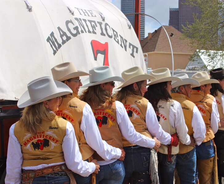The women of the Magnificent 7 Wagon pose for a photo before the parade.