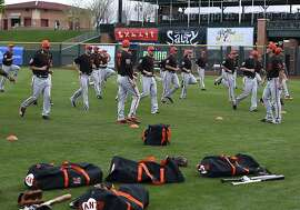 San Francisco Giants run during a spring training baseball practice on Monday, Feb. 19, 2018 in Scottsdale, Ariz. (AP Photo/Ben Margot)