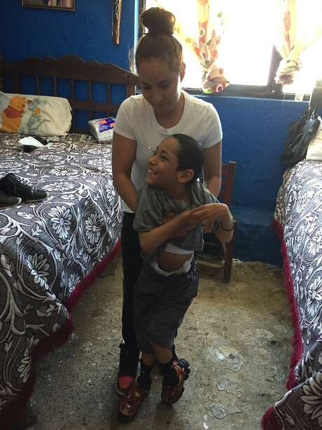 Maria Bucio at home in Mexico with her son Manuel, 10. Photo: Maria Bucio