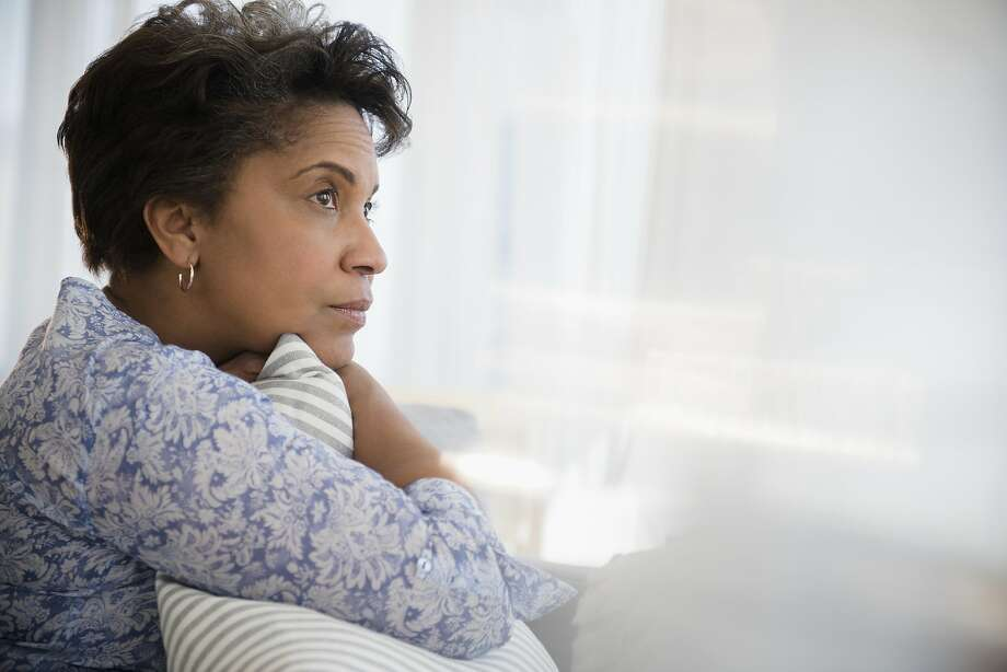 A woman is worried if her husband is straying. Photo: JGI/Jamie Grill, Getty Images/Blend Images