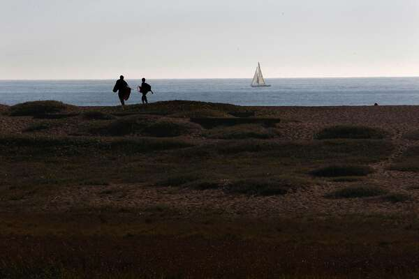 Visitors return to Rodeo Beach in the Marin Headlands in Sausalito, Calif. on Thursday Oct. 17, 2012, after the partial federal government shutdown came to an end.