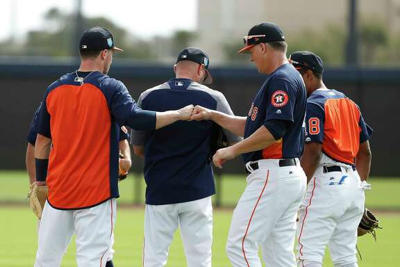Houston Astros manager A.J. Hinch fist bumps Alex Bregman (2) after drills during spring training at The Ballpark of the Palm Beaches, Tuesday, Feb. 20, 2018, in West Palm Beach.
