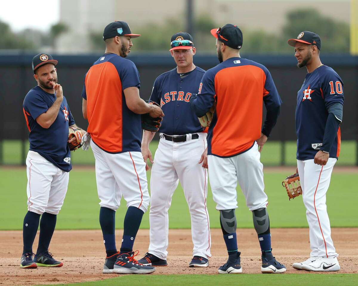 Houston Astros manager A.J. Hinch gathers Jose Altuve (27), Carlos Correa (1), Marwin Gonzalez (9), and Yuli Gurriel (10) during spring training at The Ballpark of the Palm Beaches, Tuesday, Feb. 20, 2018, in West Palm Beach.