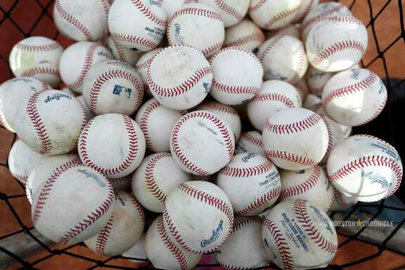 A basket of baseballs awaits hitters during spring training at The Ballpark of the Palm Beaches, Tuesday, Feb. 20, 2018, in West Palm Beach.