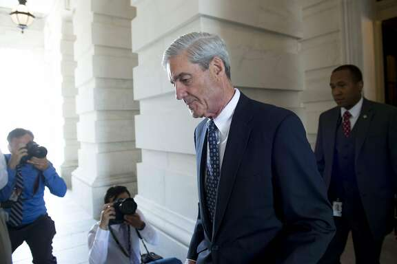 (FILES) In this file photo taken on June 21, 2017 former FBI Director Robert Mueller, special counsel on the Russian investigation, leaves following a meeting with members of the US Senate Judiciary Committee at the US Capitol in Washington, DC. Special prosecutor Robert Mueller unveiled charges of lying on February 20, 2018 against a lawyer linked to a former campaign aide of President Donald Trump, as the probe into Russian election meddling gains pace. Mueller's powerful team of investigators accused Alex Van Der Zwaan of knowingly making false statements about his communications with Richard Gates, a former senior official on the Trump campaign who is under indictment on money laundering and tax-related charges linked to his work in Ukraine.  / AFP PHOTO / SAUL LOEBSAUL LOEB/AFP/Getty Images