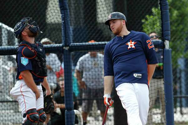 Houston Astros first baseman AJ Reed (23) reacts after popping up as he took live batting practice from pitcher Gerrit Cole during spring training at The Ballpark of the Palm Beaches, Tuesday, Feb. 20, 2018, in West Palm Beach.