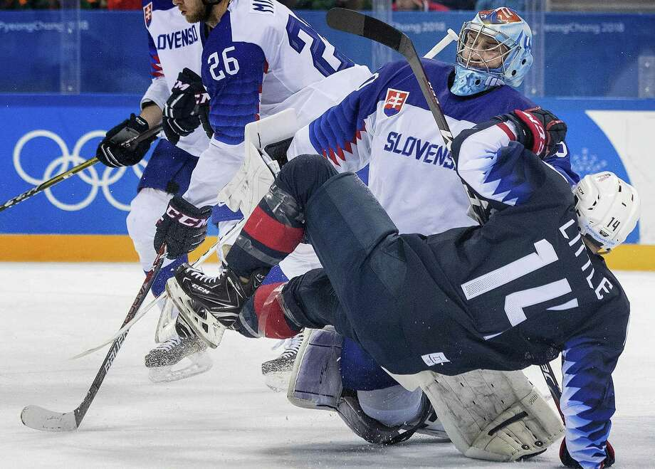 Team USA's Broc Little (14) gets tangled up with Slovakia goalie Jan Laco (50) in the third period on Tuesday, Feb. 20, 2018 during the Pyeongchang Winter Olympics at Gangneung Hockey Centre in South Korea. (Carlos Gonzalez/Minneapolis Star Tribune/TNS) Photo: Carlos Gonzalez / TNS / Minneapolis Star Tribune