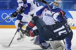 Team USA's Broc Little (14) gets tangled up with Slovakia goalie Jan Laco (50) in the third period on Tuesday, Feb. 20, 2018 during the Pyeongchang Winter Olympics at Gangneung Hockey Centre in South Korea. (Carlos Gonzalez/Minneapolis Star Tribune/TNS)