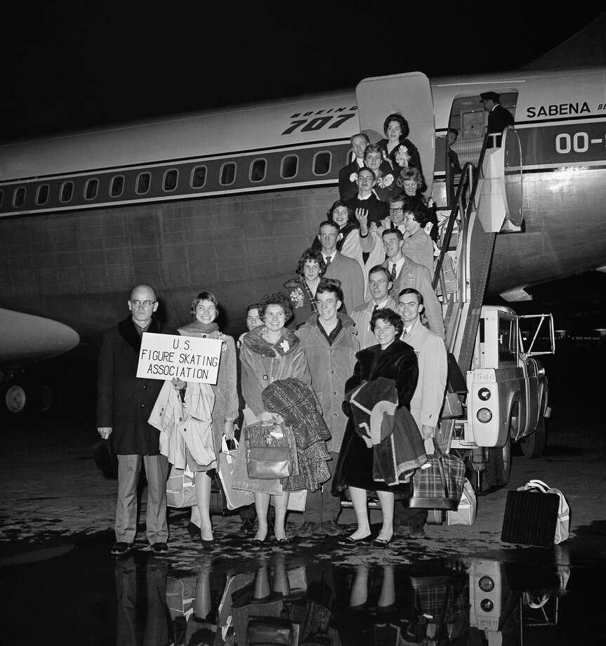 FILE —Members of the U. S. Figure Skating Team pose before boarding Belgian Sabena airline plane at Idle Wild airport, Feb. 14, 1961, New York. The plane crashed Feb. 15 near the Brussels, Belgium Airport killing all on board. From left in front row are: Deane McMinn, Lomita, Calif., coach and manager, Laurence Owen, Boston, Steffi Wethersfield; Colorado Springs, Colo, and Phodie Michelson; Long Beach, Calif. From left on the bottom: Douglas Ramsey; Detroit, Gregory Kelley; Colorado Springs, Bradley Lord; Boston, Mirabel Caen; Boston, Dudley Richards; Boston, Bill Hickox; Colorado Springs, Ray Hadley; Seattle; Laurie Hickox, Colorado Springs, Larry Pierce; Indianapolis, Ila Rae Hadley; Colorado Springs, Roger Campbell; Los Angeles, Diane Sherbloom; Los Angeles, Donna Lee Carrier; Los Angeles, and Bob and Pat Dineen; New York. Photo: Matty Zimmerman/AP