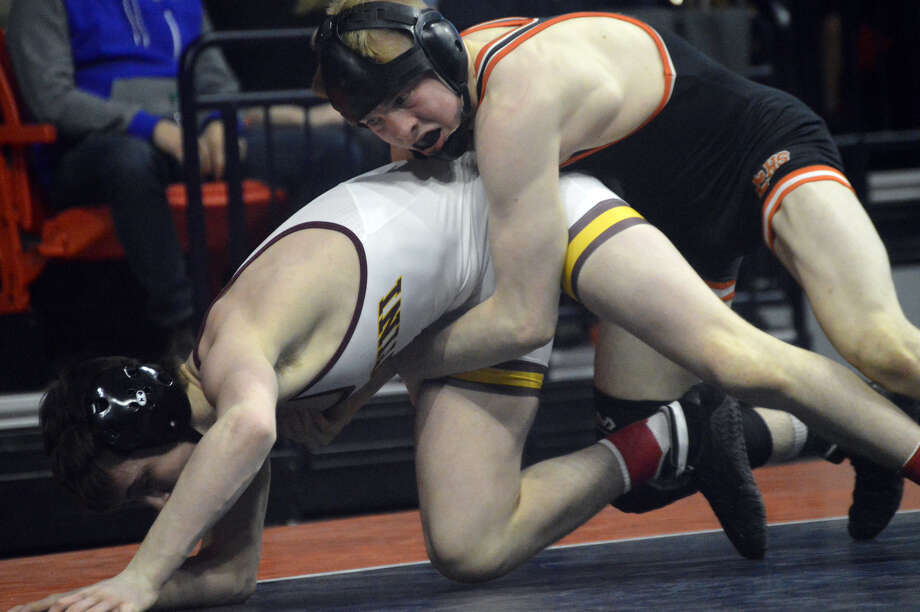 Edwardsville's Noah Surtin, top, competes in the championship match of the 113-pound weight class at the IHSA Class 3A state tournament.