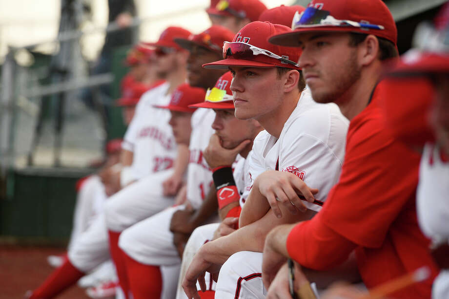 Lamar baseball players watch from the dugout during their season opener against Missouri State in the Cardinal Classic tournament on Friday afternoon.  Photo taken Friday 2/16/18 Ryan Pelham/The Enterprise Photo: Ryan Pelham, Ryan Pelham/The Enterprise / ©2017 The Beaumont Enterprise/Ryan Pelham