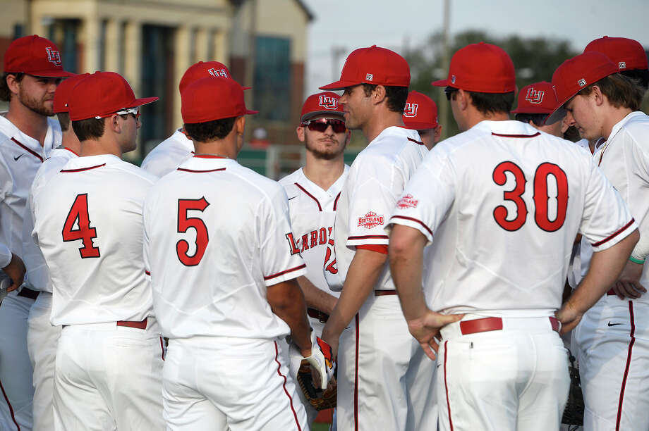 Lamar baseball coach Will Davis talks to players before their season opener against Missouri State in the Cardinal Classic tournament on Friday afternoon.  Photo taken Friday 2/16/18 Ryan Pelham/The Enterprise Photo: Ryan Pelham, Ryan Pelham/The Enterprise / ©2017 The Beaumont Enterprise/Ryan Pelham