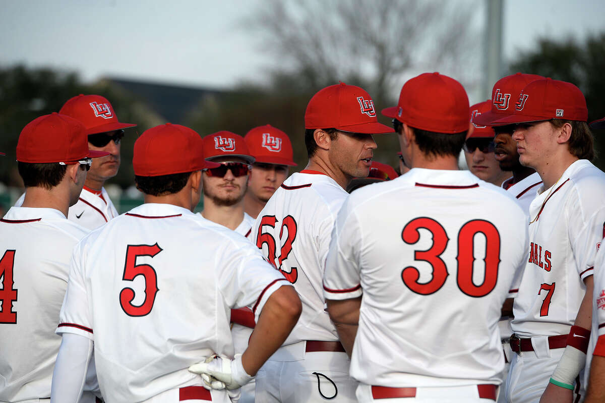 Lamar baseball coach Will Davis talks to players before their season opener against Missouri State in the Cardinal Classic tournament on Friday afternoon. Photo taken Friday 2/16/18 Ryan Pelham/The Enterprise