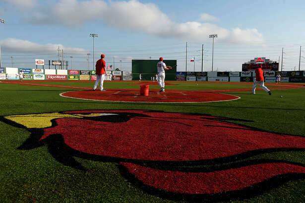Lamar    baseball  players warm up before their season opener against Missouri State in the Cardinal Classic tournament on Friday afternoon.   (Ryan Pelham/The Enterprise)