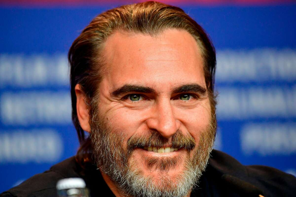 """US actor Joaquin Phoenix attends a press conference for the film """"Don't Worry, He Won't Get Far on Foot"""" in competition during the 68th edition of the Berlinale film festival in Berlin on February 20, 2018. / AFP PHOTO / Tobias SCHWARZTOBIAS SCHWARZ/AFP/Getty Images"""