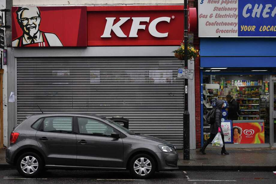 Pedestrians pass outside a closed KFC fast food store in south London on February 19, 2018. US fast food chain KFC said on February 19 it had been forced to close many restaurants in Britain because of a new supplier failing to deliver chicken in time, generating some tongue-in-cheek outrage on Twitter. Photo: BEN STANSALL /AFP /Getty Images / AFP or licensors