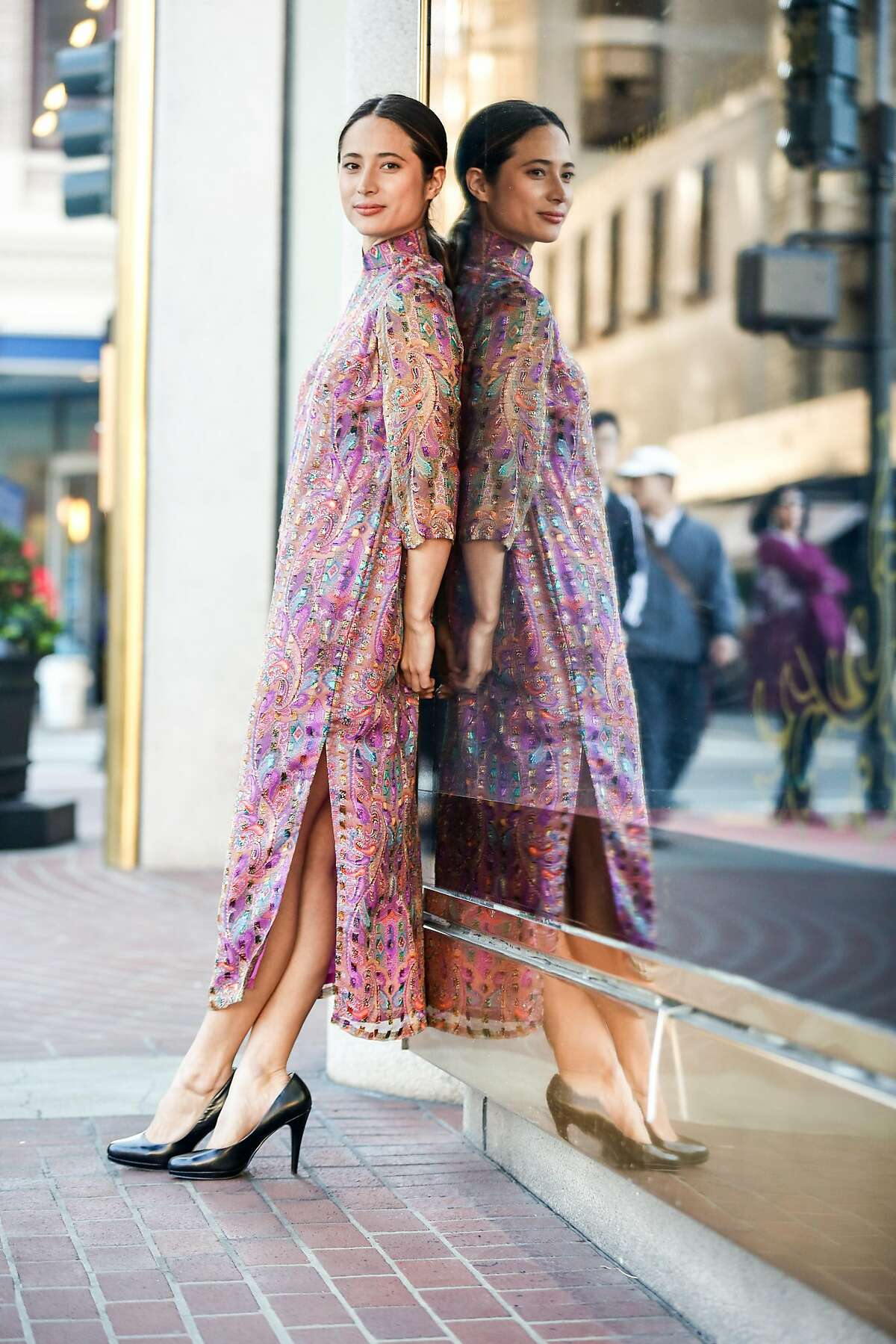 Model Hannah Token wears a Cecilia Chiang dress designed in honor of Lunar New Year at Saks Fifth Avenue on Friday, February 15, 2018 in San Francisco, California.