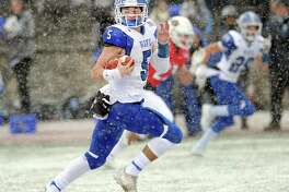 Darien quarterback Jack Joyce runs for a first-quarter touchdown against Greenwich during the Class LL championship game on Dec. 9 at Boyle Stadium in Stamford. Darien won the state title, defeating Greenwich 31-22.