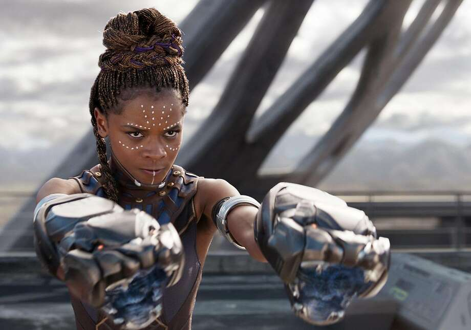 """Letitia Wright plays the king's brainy little sister in the Afrofuturist blockbuster """"Black Panther."""" Photo: Film Frame, Marvel Studios-Walt Disney"""