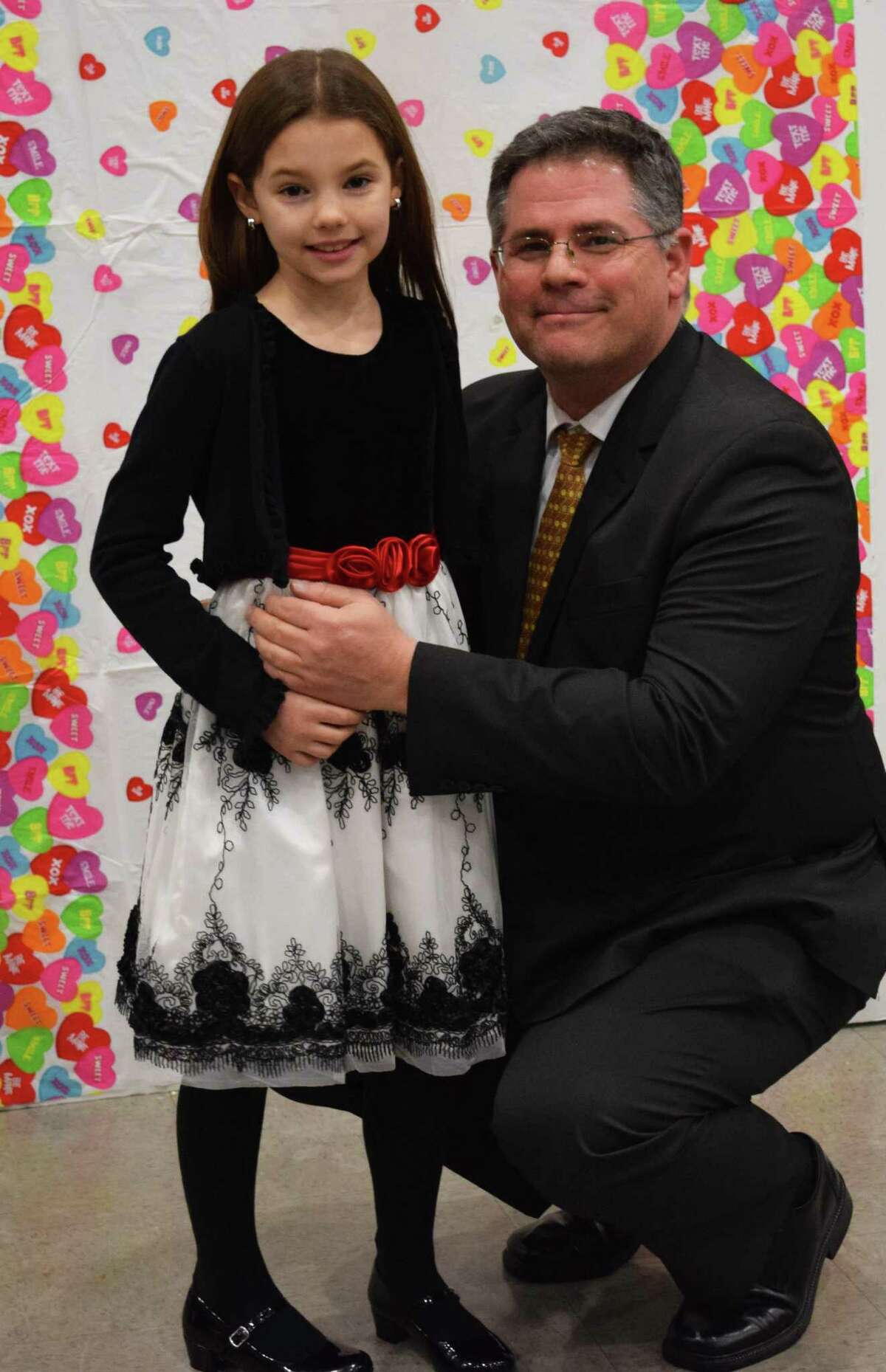 Spectrum/Fred Peloso and his daughter, Samantha, 10, pause to have their photo taken at the start of the New Milford Girl Scouts annual Sweetheart Dance, sponsored this year by Troop 40236, at New Milford High School Feb. 9, 2018.