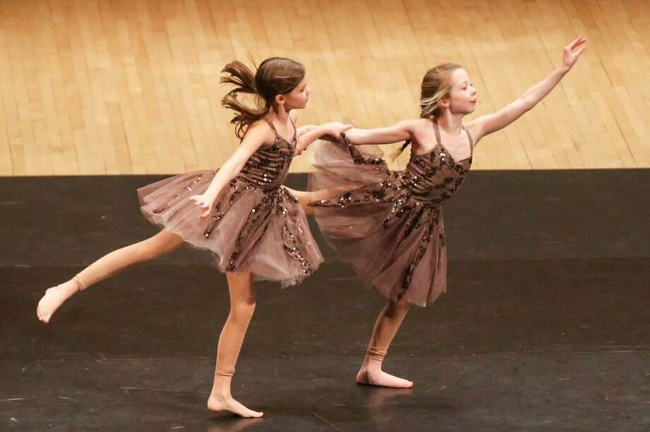 Katelyn Brunner and Avery Rubini, who are members of D-Tour, New Milford's Studio D's dance company, perform on stage at Carnegie Hall in New York City during the dance company's performance at the 12th annual Performing Arts Educational. Photo: Courtesy Of Studio D / The News-Times Contributed