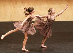 Katelyn Brunner and Avery Rubini, who are members of D-Tour, New Milford's Studio D's dance company, perform on stage at Carnegie Hall in New York City during the dance company's performance at the 12th annual Performing Arts Educational.